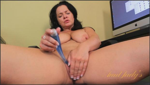 Auntjudys.com- Pepper Ann toys her pussy in her office.