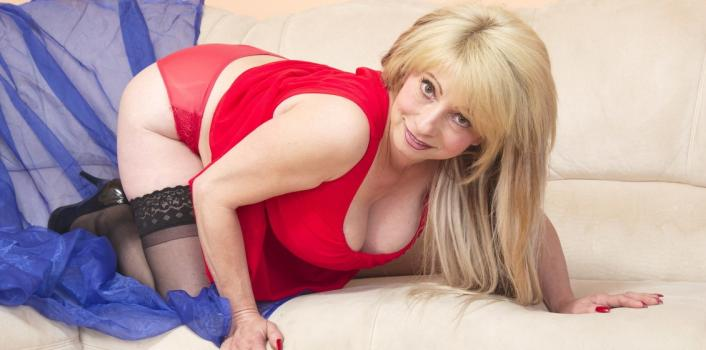 Mature.nl- Sexy busty mature lady blows her two toyboys and gets fucked in return.